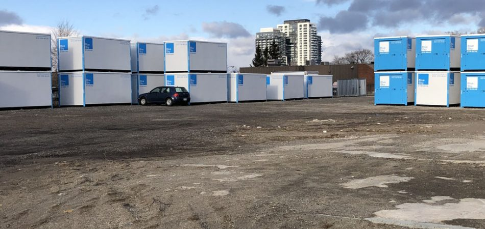 Outdoor Storage Containers and A Car
