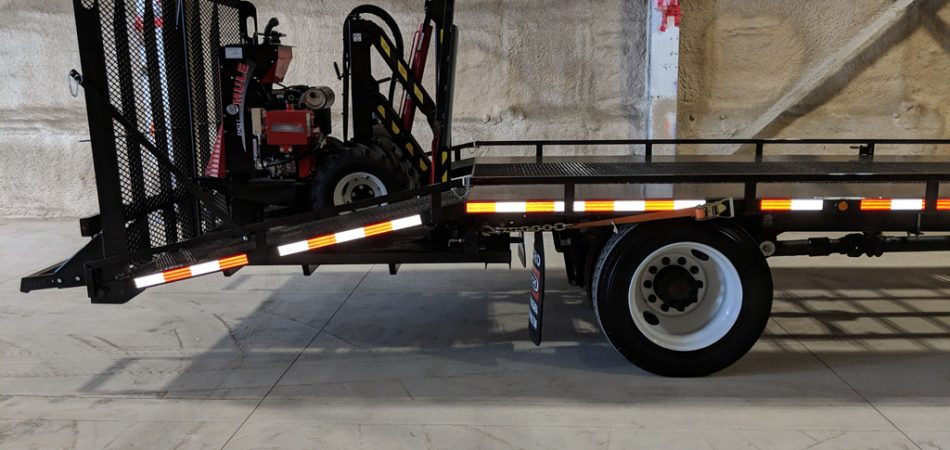Photo of Truck Trailer with Forklift on It