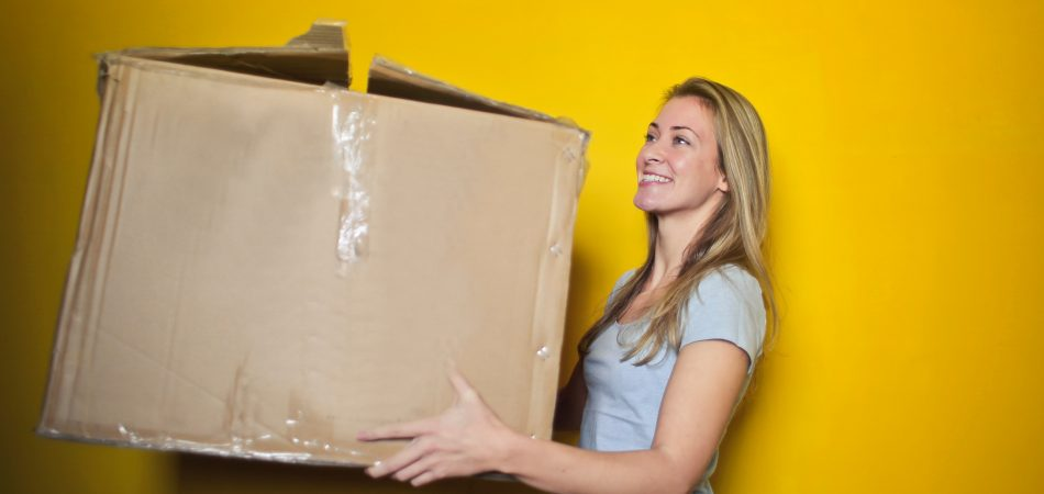women moving box