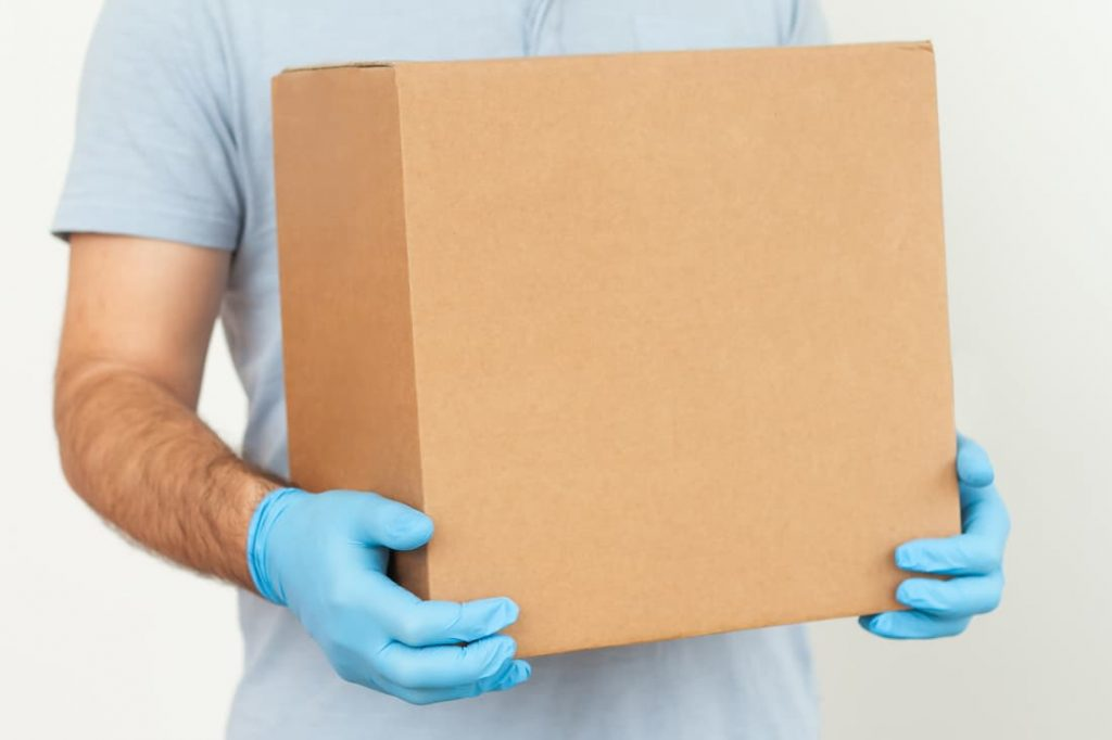 men holding a box with gloved hands